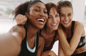 3 women in gym selfie